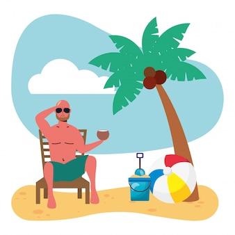 Mann, der badeanzug sitzt im strandkorb, der kokosnuss isst