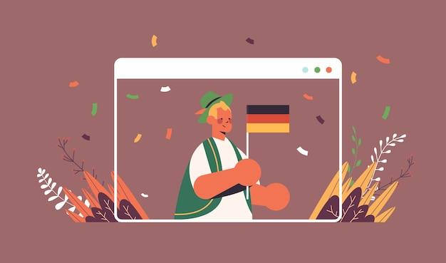 Mann, der deutschlandfahne oktoberfest-partyfeierkonzeptmann in traditioneller kleidung hält, die spaß webbrowserfenster hat
