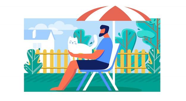 Mann, der draußen freizeit auf deckchair verbringt