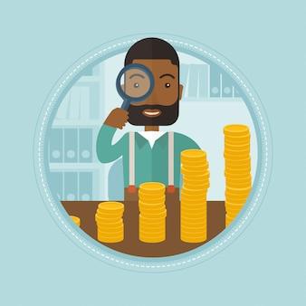 Mann, der durch vergrößerungsglas goldenen münzen betrachtet
