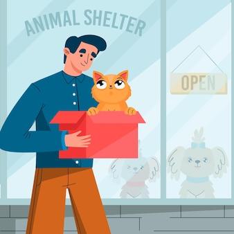 Mann, der eine katze vom tierheim adoptiert