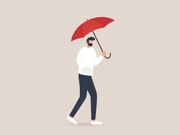 Mann, der einen regenschirm hält, der unter dem regen geht