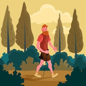Mann, der einen spaziergang im wald nimmt