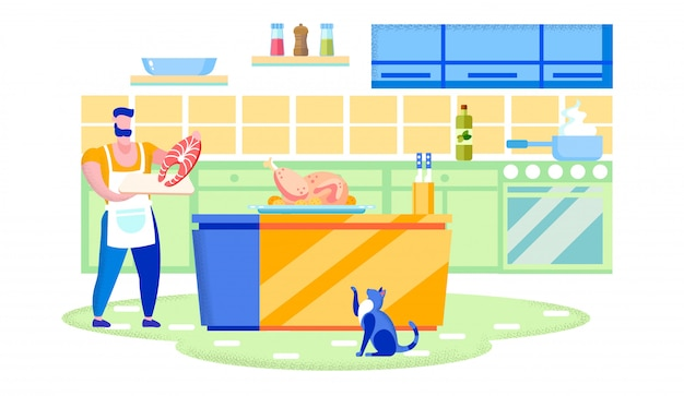 Mann, der feiertagsdinner in der küche mit katze kocht