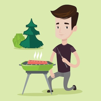 Mann, der fleisch auf dem grill kocht.