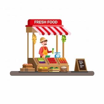 Mann, der frisches gemüse und obst im traditionellen hölzernen marktlebensmittelstand verkauft. karikatur flacher illustrationsvektor isoliert