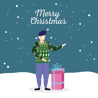 Mann der frohen weihnachten mit hässlicher strickjackengeschenk-schneefeier