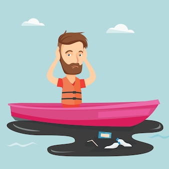 Mann, der in ein boot im verschmutzten wasser schwimmt.