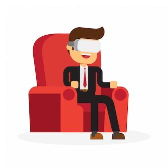 Mann, der in tragendem sturzhelm der virtuellen realität des lehnsessels sitzt