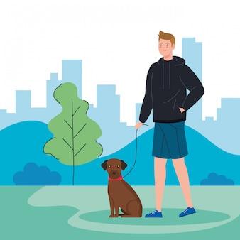 Mann, der mit hund in landschaft geht