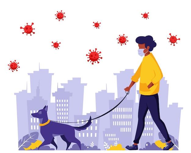 Mann, der mit hund während der pandemie geht