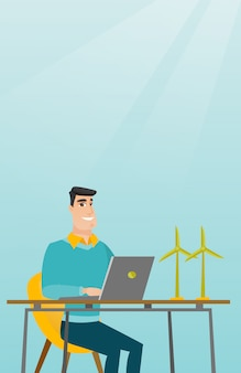 Mann, der mit modell von windkraftanlagen arbeitet.