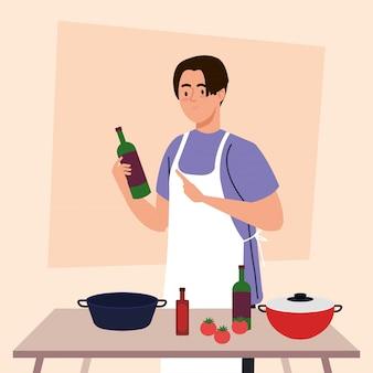 Mann, der mit schürze und holztisch mit töpfen, gemüse und küchenbedarf kocht