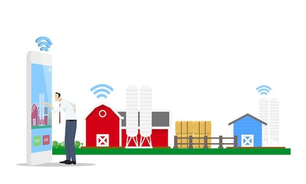 Mann, der mobiltelefonanwendung verwendet, um intelligente farm zu steuern