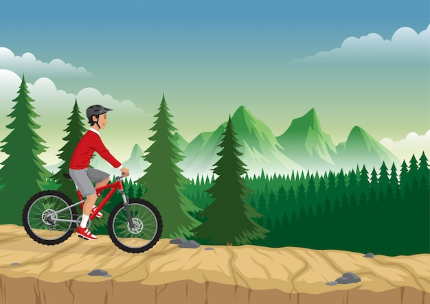 Mann, der mountainbike auf dem berg reitet
