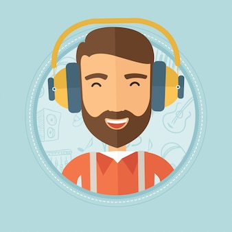 Mann, der musik in den kopfhörern hört.