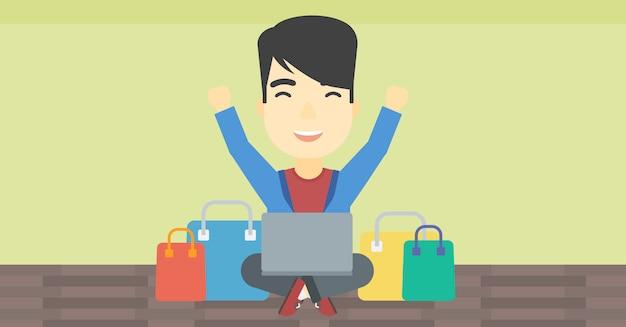 Mann, der online unter verwendung seines laptops kauft.