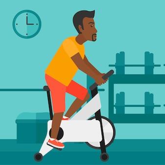 Mann, der radfahrenübung tut