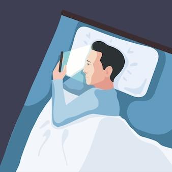 Mann, der smartphone im bett verwendet