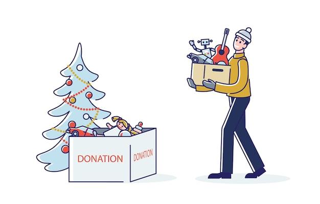 Mann, der spielzeug für weihnachts-wohltätigkeitsveranstaltung spendet