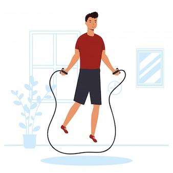 Mann, der springseil-sportaktivität im haus übt