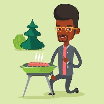 Mann, der steak auf grill grillt.