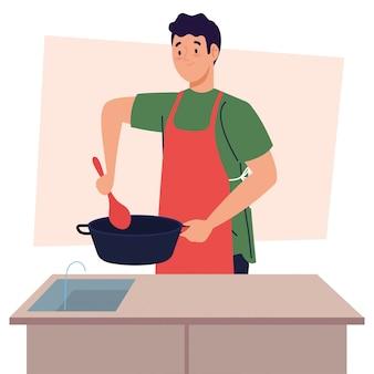 Mann, der unter verwendung der schürze mit topf in der küchenszene kocht