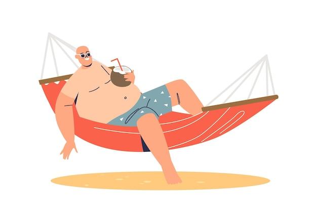 Mann entspannt sich in der hängematte mit kokosnuss