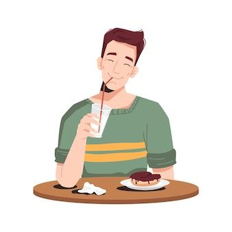 Mann genießt dessert kuchen und milchshake auf dem tisch