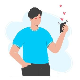 Mann hält ein telefon in der hand, er hat eine liebesbotschaft erhalten