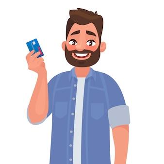 Mann hält eine kreditkarte in der hand.