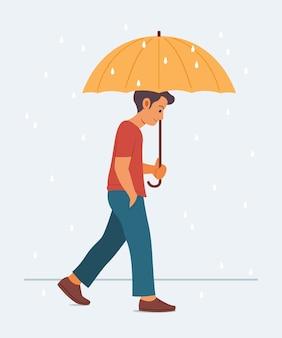Mann halten regenschirm und genießen, im regen zu gehen.