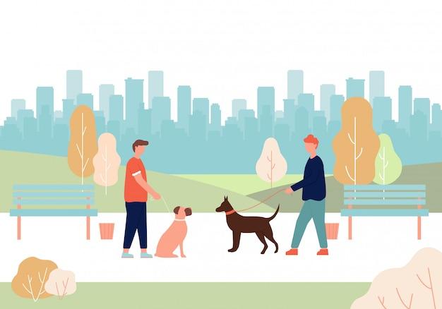 Mann-hundebesitzer, der in der hand leine dobermann-boxer hält