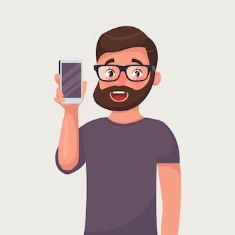 Mann in den gläsern mit bart zeigt das telefon.