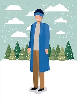 Mann in der schneelandschaft mit winterkleidung