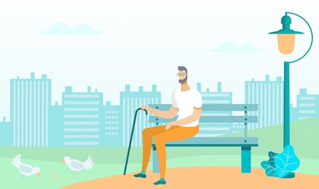 Mann in gläsern mit stock sitzt auf bank im park.
