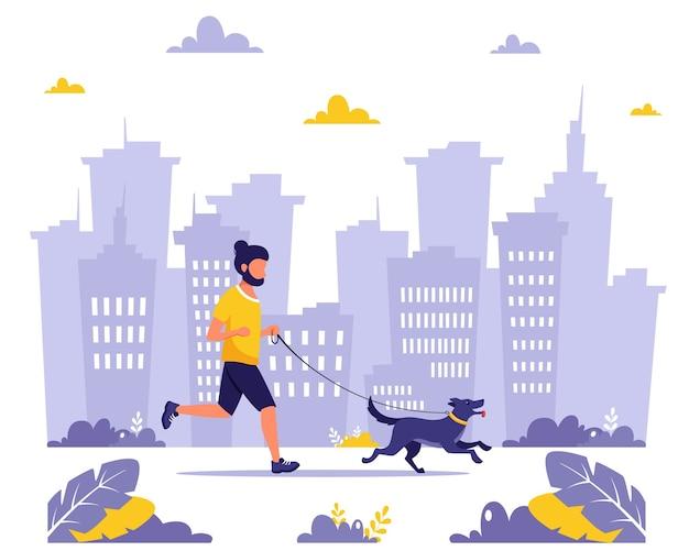 Mann läuft mit hund in der stadt