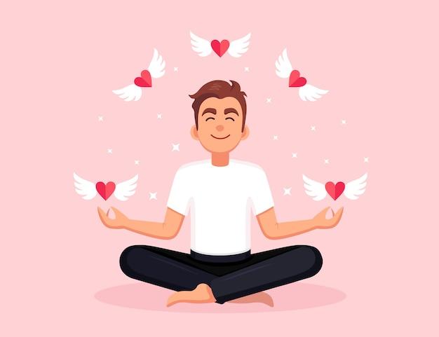 Mann macht yoga. yogi sitzt in padmasana lotus pose, meditiert, entspannt mit fliegendem herzen