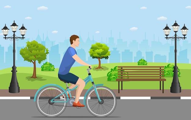 Mann mit dem fahrrad im öffentlichen park,
