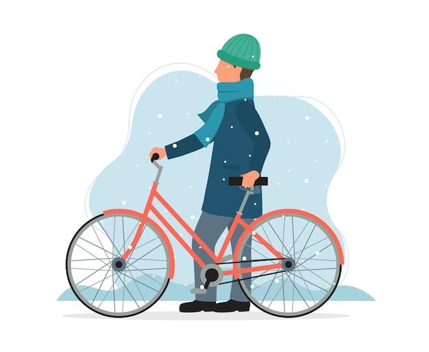 Mann mit dem fahrrad im winter.