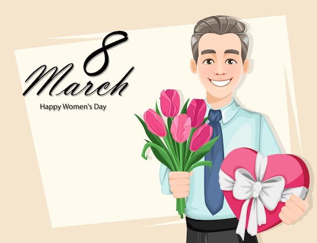 Mann mit einem strauß tulpen und einer geschenkbox