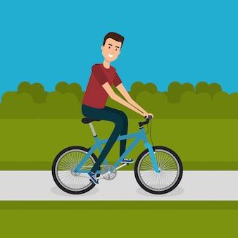 Mann mit fahrrad in der landschaft