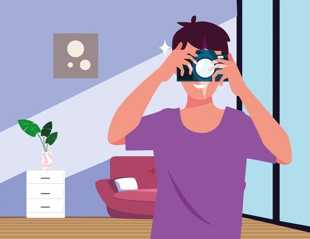 Mann mit fotoapparat im wohnzimmer