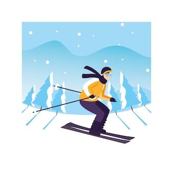 Mann mit gebirgsski in der landschaft mit schneefällen