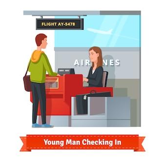 Mann mit großem koffer check-in am flughafen