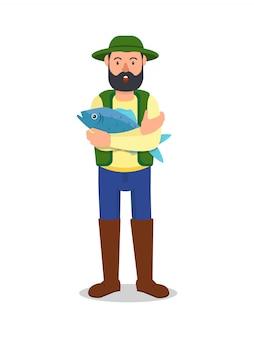 Mann mit großen blauen fischen in der hand