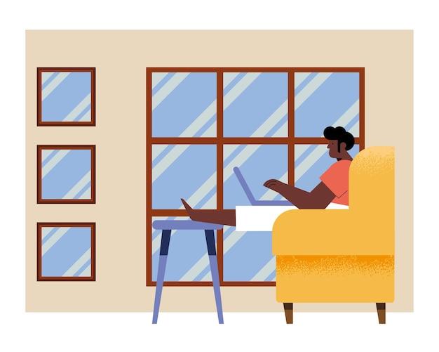 Mann mit laptop auf der couch
