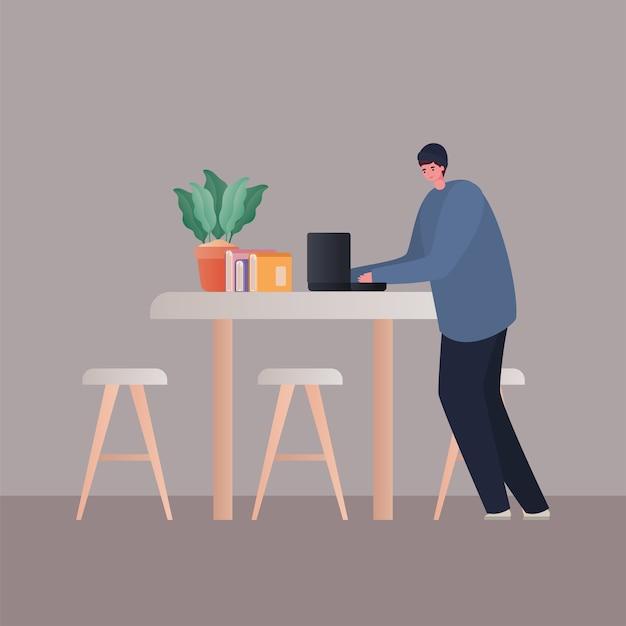 Mann mit laptop, der an tischdesign von arbeit vom hauptthema arbeitet