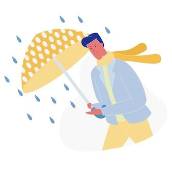 Mann mit regenschirm, der gegen wind und regen geht