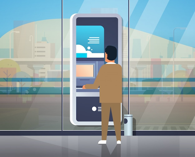 Mann mit self-service-geldautomaten
